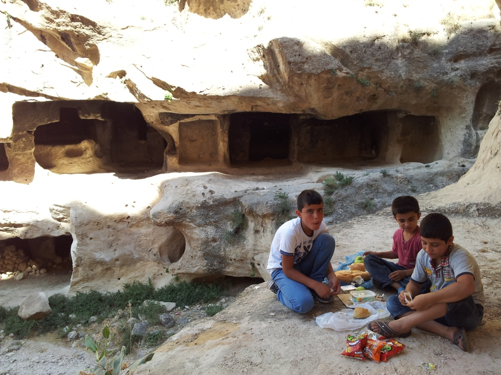 Children picnic in the canyon  and caves of ancient Hasankeyf
