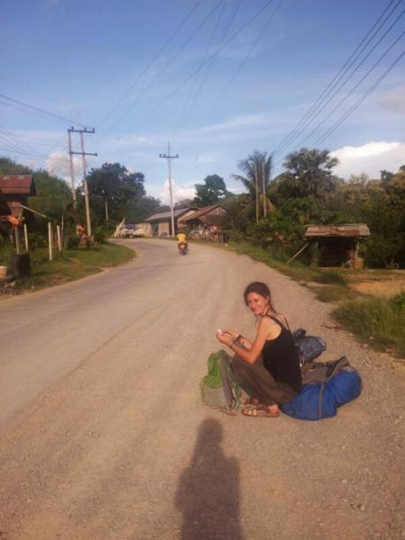 Sydney waiting for a truck or car in Pakmong, Laos...
