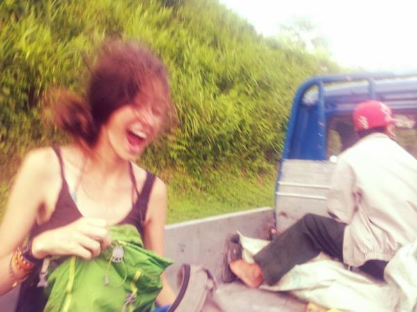 Sydney laughs as we're thrown into the air in one of the most dangerous rides I have ever hitchhiked...I'm thankful that she's so laidback!
