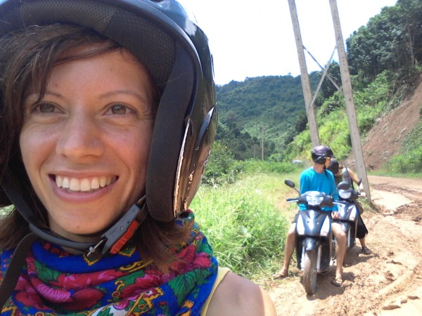 I'm VERY happy to be on a motorbike again in Laos! Pawel and Camille are stuck in the mud behind me!