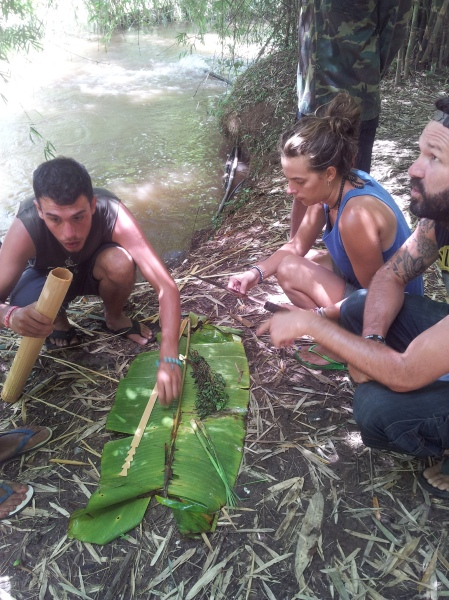 Yannick, Camille and Nick learn to cook jungle food by stuffing bamboo with food and cooking it on the fire