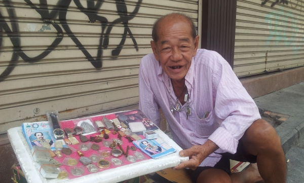 "This man sits on the street all day with his little display of trinkets to sell. He asks me if I want to hire a man for the night!!! ""You only live once!"" he says!"