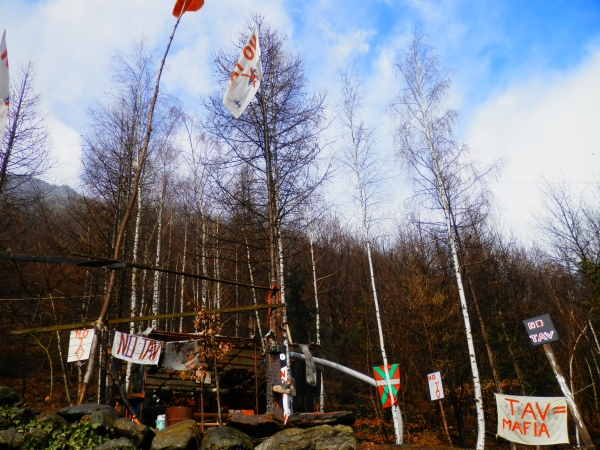 Resistance flags and activist structures at the site of the destruction