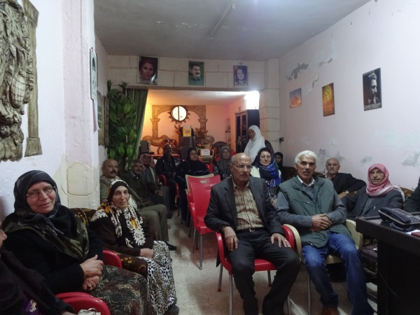 In a neighbourhood meeting about anti-capitalism and feminism