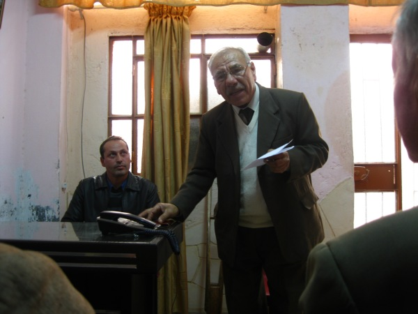 The man on the left lectures in Kurdish about feminism and anti-capitalism, whilst the older man translates into Arabic